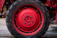 Big red wheel of the tractor. Close-up Royalty Free Stock Image