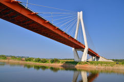 A big red and white bridge through the river Oka Stock Images