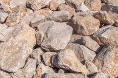 Big red and yellow sea stone on coast on island Rhodes Royalty Free Stock Photography