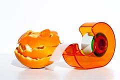A big repair job. An orange peel and selotape Royalty Free Stock Photography