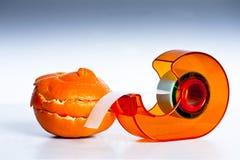 A big repair job. An orange peel and selotape Royalty Free Stock Photo