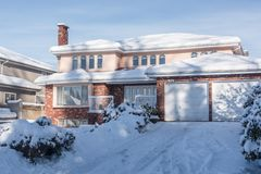 Big family house in snow on winter season in Canada. Big residential house in snow on winter season in Canada royalty free stock photography