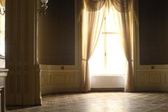 Big rich hall. With big window in palace stock image