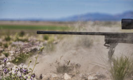 Big rifle muzzle blast. Dust and rocks fly the moment a big bore rifle goes off Royalty Free Stock Photography