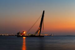 A big rig is anchored off the Dubai, UAE coast. Dubai, UAE: A big rig is anchored off the Dubai coast. Jebel Ali Port is in the background Royalty Free Stock Image