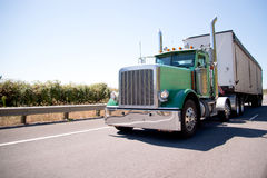 Big rig attractive green semi truck with bulk trailer Stock Image