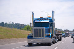Big rig blue classic custom tuning semi truck. Thoroughbred classic big rig semi truck with the custom personal tuning and high tailpipes on the international Stock Photos