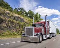 Free Big Rig Classic Dark Red Semi Truck With Stylish Accessories Transporting Load In Refrigerator Semi Trailer Driving On The Stock Photo - 191354870