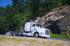 Big rig classic semi truck flat bed trailer green highway Royalty Free Stock Images