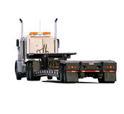 Big rig with drop-deck trailer Stock Images