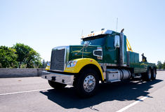 Big rig equipped towing semi truck on road Royalty Free Stock Photo