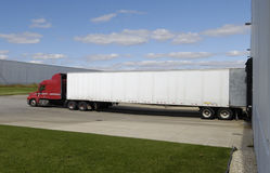 Big Rig Loading Up. A big truck which is loading or unloading stock photo