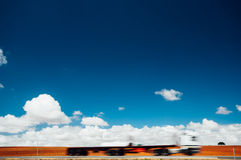 Big rig passing the highway with motion blur Stock Images