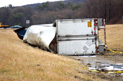 Big Rig Roll Over. A tractor trailer rolls over into the median Stock Images