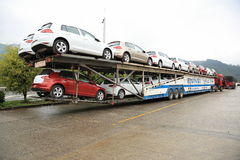 Big rig semi-truck car hauler with new cars. On road Royalty Free Stock Images