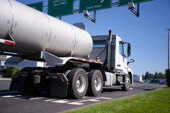 Big rig  semi truck with tank trailer Stock Photos