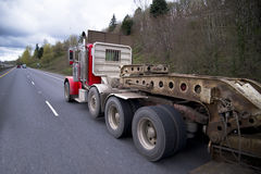 Big rig with step down powerful flat bed trailer Stock Images
