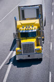 Big rig yellow classic power semi truck reefer trailer interstat Royalty Free Stock Photography