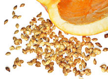 Big ripe pumpkin and baked seeds fresh out of the oven Stock Photography