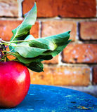 Big Ripe Red Apple with green  leaves on vintage wooden table. F Royalty Free Stock Images