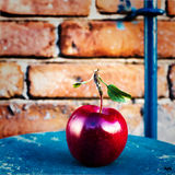 Big Ripe Red Apple with green  leaves on vintage wooden table. F Stock Image