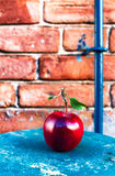 Big Ripe Red Apple with green  leaves on vintage wooden table. F Stock Images
