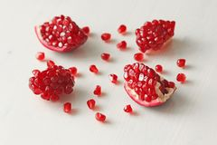 Big Ripe Red Granets or Garnets. Fruits of Red Ripe Pomegranate. On the White Background. Vegetarian Concept, Organic Vitamins, Detox. Organic and Benefit Stock Images