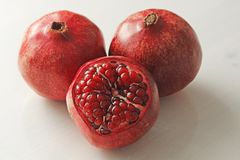 Big Ripe Red Granets or Garnets. Fruits of Red Ripe Pomegranate. On the White Background. Vegetarian Concept, Organic Vitamins, Detox. Organic and Benefit Stock Photography