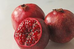 Big Ripe Red Granets or Garnets. Fruits of Red Ripe Pomegranate. On the White Background. Vegetarian Concept, Organic Vitamins, Detox. Organic and Benefit Stock Photos
