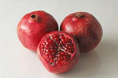 Big Ripe Red Granets or Garnets. Fruits of Red Ripe Pomegranate. On the White Background. Vegetarian Concept, Organic Vitamins, Detox. Organic and Benefit Royalty Free Stock Photo