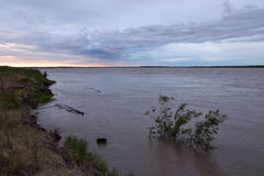 Big river overflowing with muddy water. Stock Image