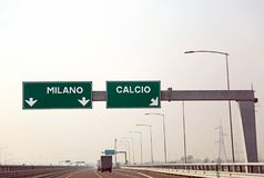 Road sign on the Italian motorway for the cities called MILANO a. Big road sign on the Italian motorway for the cities called MILANO and CALCIO royalty free stock image
