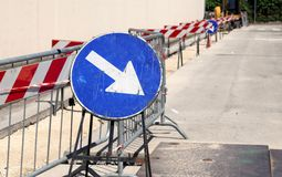 Big road signal with arrow on the excavation during the roadwork Royalty Free Stock Photo