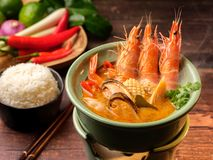 A dish of seafood soup with tiger prawns, calms and corn royalty free stock photo