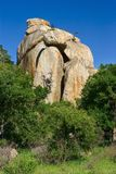 Big rock. Landscape; Big rock between green bushes; South Africa Stock Image
