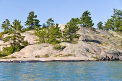 Big Rock and Evergreen Trees Royalty Free Stock Image