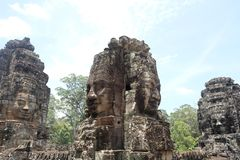 Rock faces in the temple of Bayon, Angkor, Cambodia stock photography