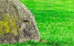 Big rock on green grass Royalty Free Stock Photo