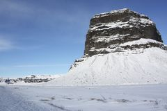 Big rock in an Iceland snow landscape Royalty Free Stock Photos
