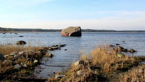 Big rock in the middle of the sea stock footage