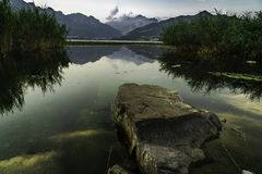 big rock mountain alps and lake stock photos
