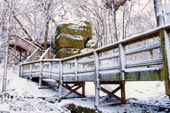 Big Rock in northern Illinois. Big Rock at Rock Cut State Park in a snow covered forest Royalty Free Stock Photo