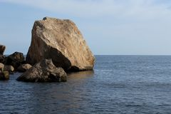 Big rock in the sea in Águilas, a village of fishers of the Mediterranean Sea, in Spain. In the image is possible to see a big rock in the Mediterranean Royalty Free Stock Photos