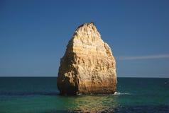 Big rock in sea. Big rock in the atlantic ocean, at Algarve, Portugal Stock Photos