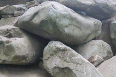 Big rock several cubes. Build a wall. Stock Photos