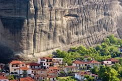 Big rock and small vilage. 's houses, Meteora, Kastraki, Greece Stock Photography