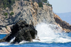 Big rock stone. A big rock stone in the Mediterranean Sea is captured by a water wave Stock Images