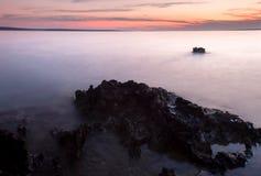 Sunset Coastline with Rock royalty free stock photos