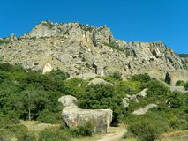 Big rocks. Cliff and big rocks in flank of mountain Stock Photography