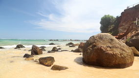 Big rocks on beautiful sandy beach in Sri Lanka stock video